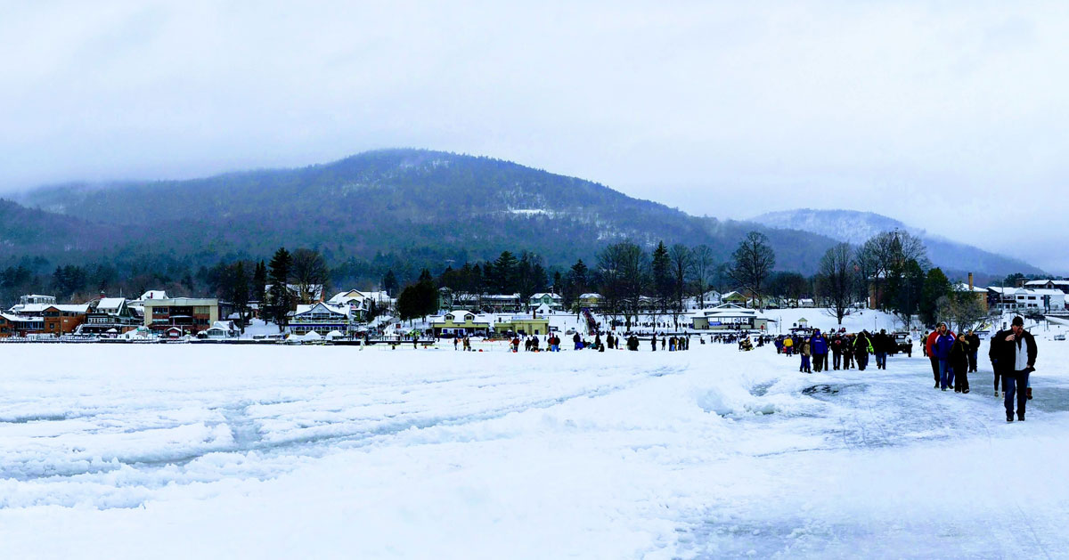 people on the ice in Lake George