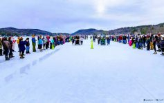 people on ice, outhouse race