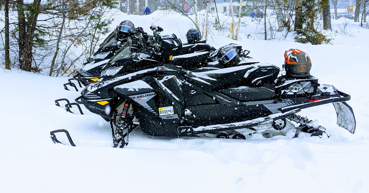 snowmobiles in a row