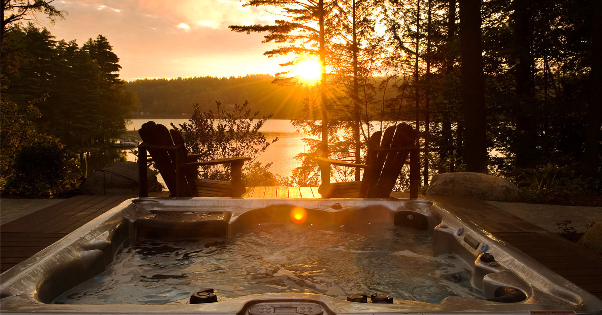 Adirondack hairs by a hot tub at sunset