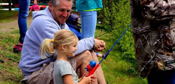 little girl fishing with dad
