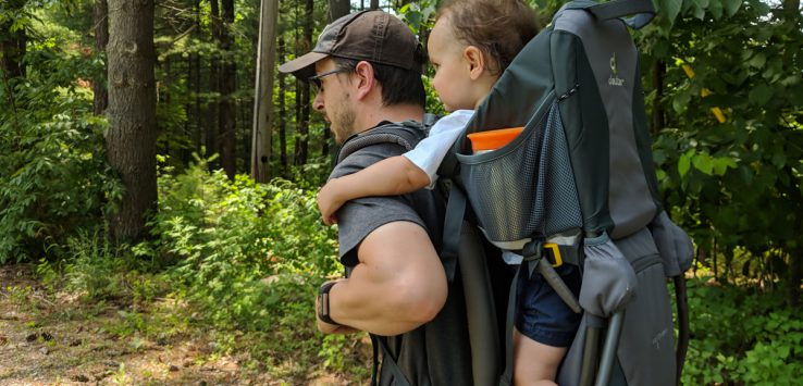 man with toddler in hiking backpack