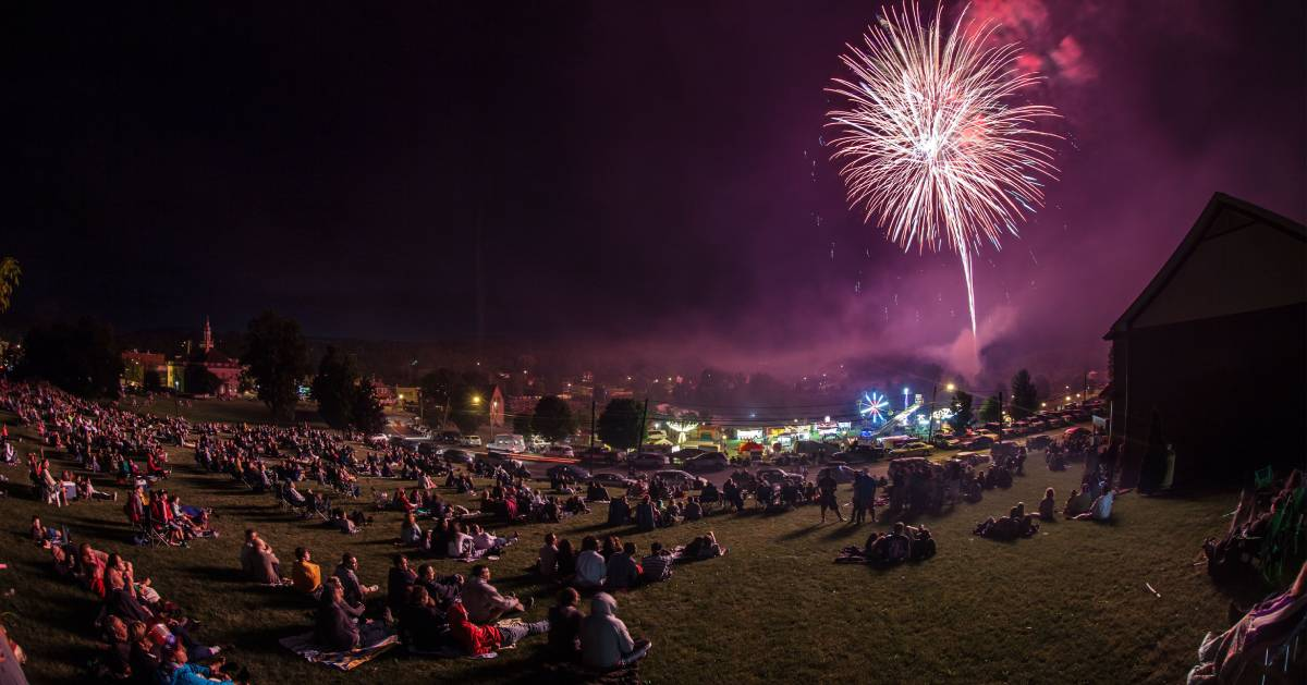 crowd of people watching fireworks