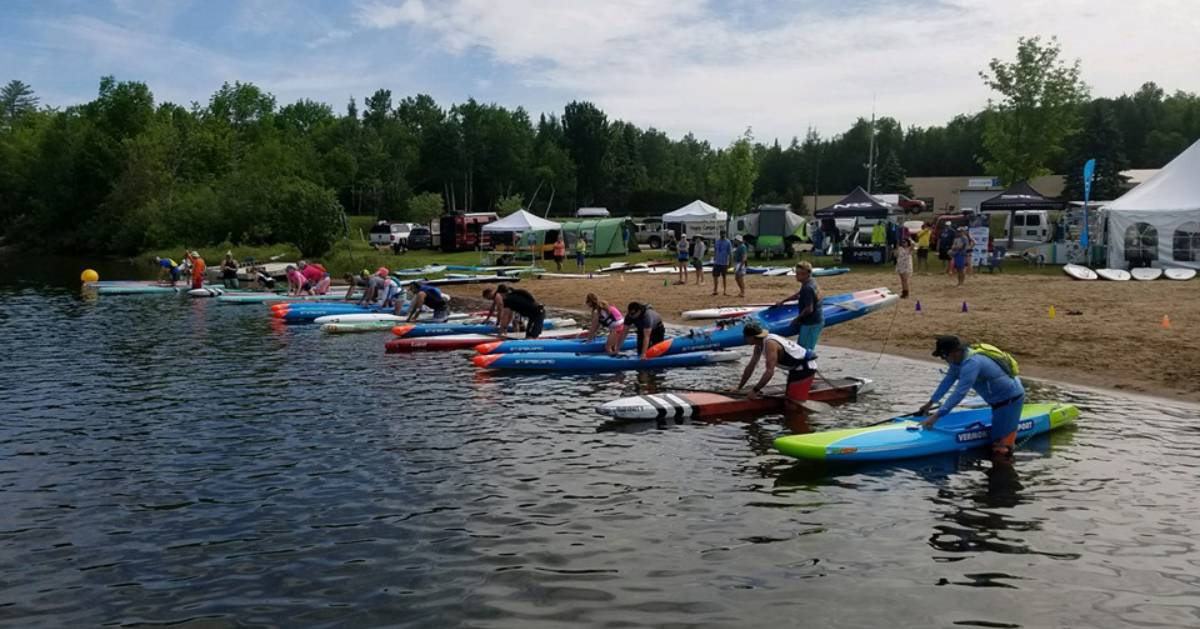 people getting ready to get on their paddleboards