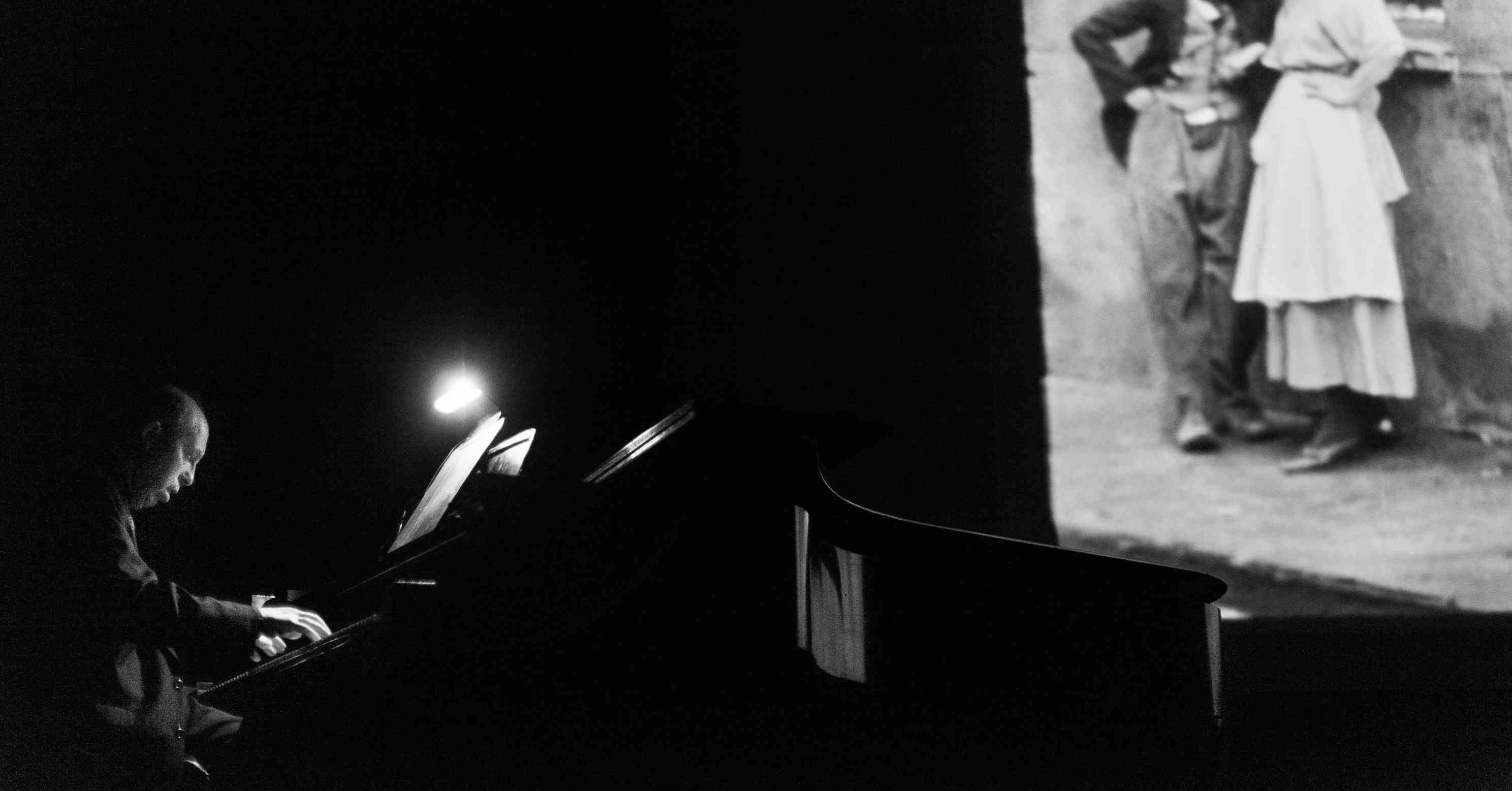 ben model accompanies a silent film on a piano