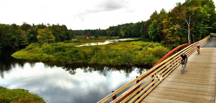 view of bikers on bridge in the Adirondacks