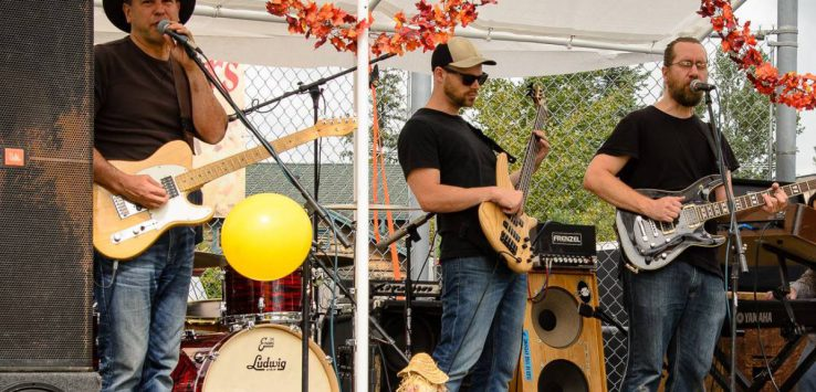 band performs on stage with fall decorations
