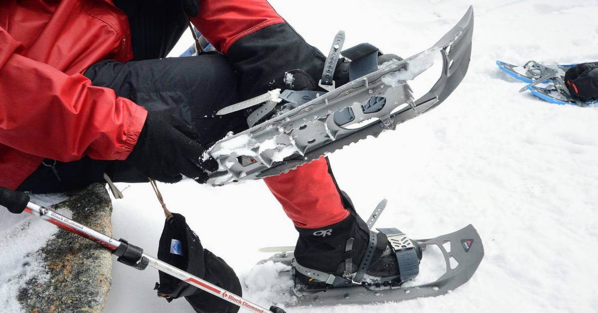 close up of person putting snowshoes on