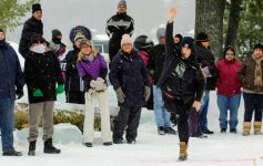 people at winter carnival, woman tossing something