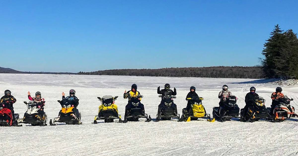 snowmobilers in a line
