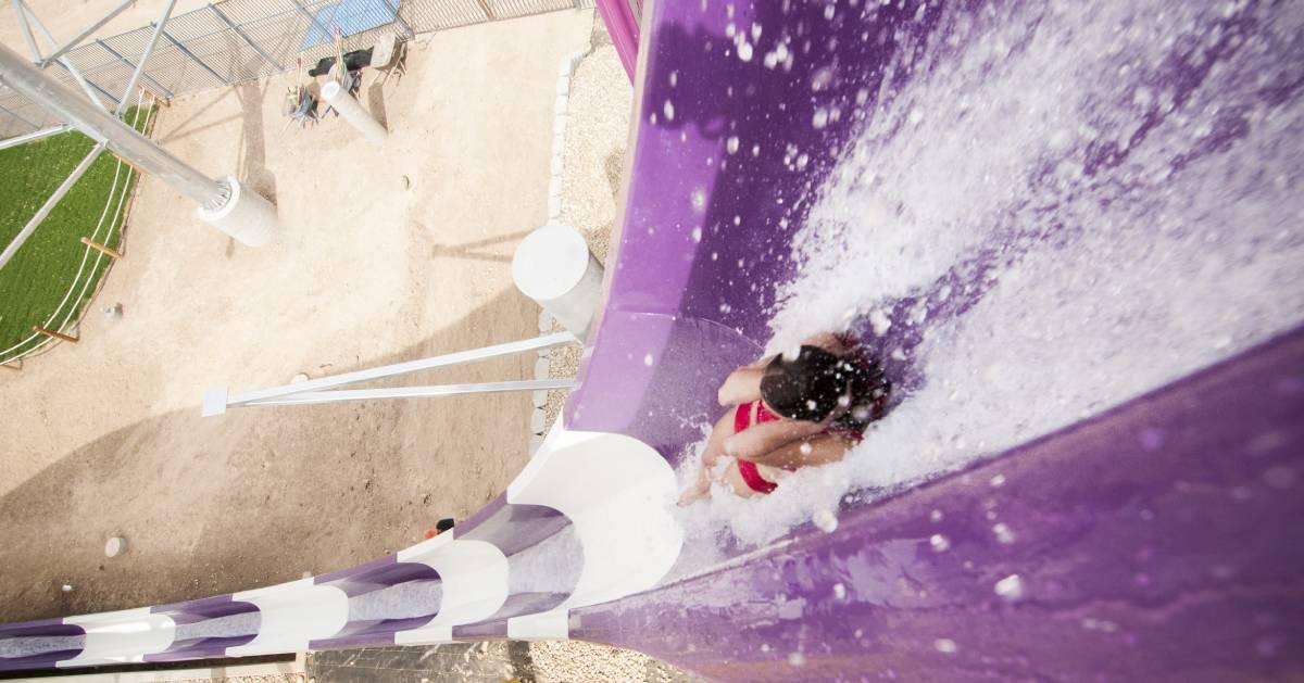women going down water slide