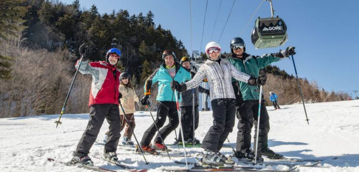 group of skiers smiling for photo