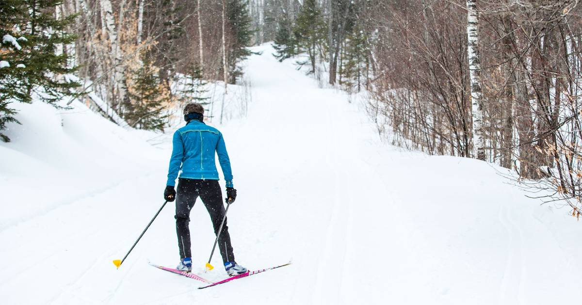 back of person cross country skiing