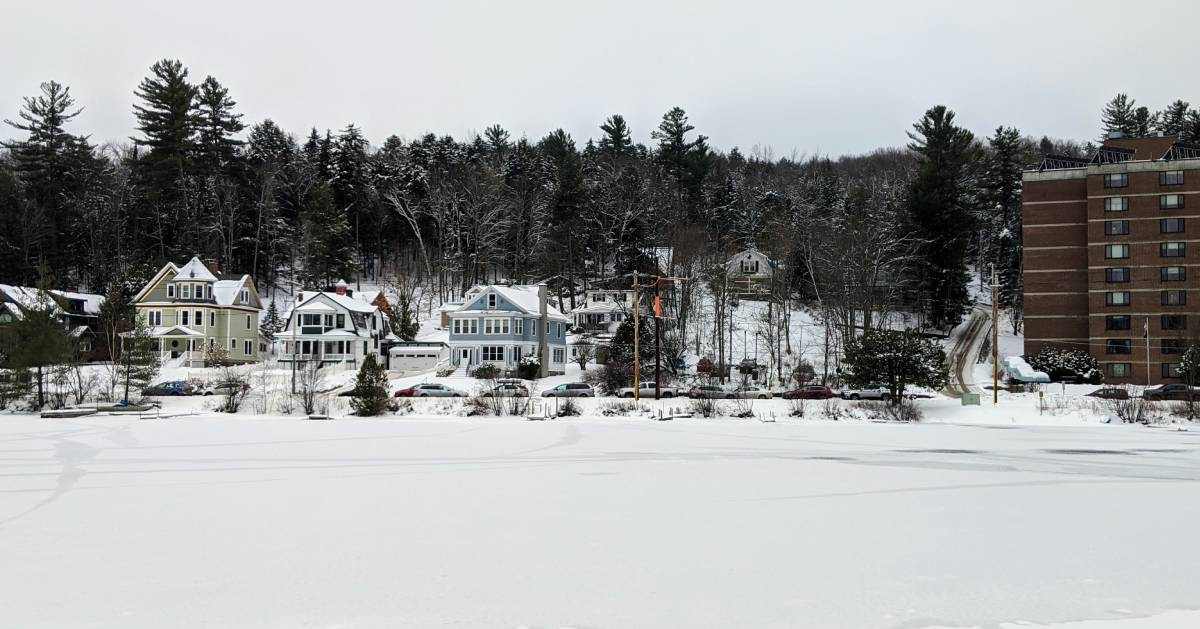 houses along frozen lake
