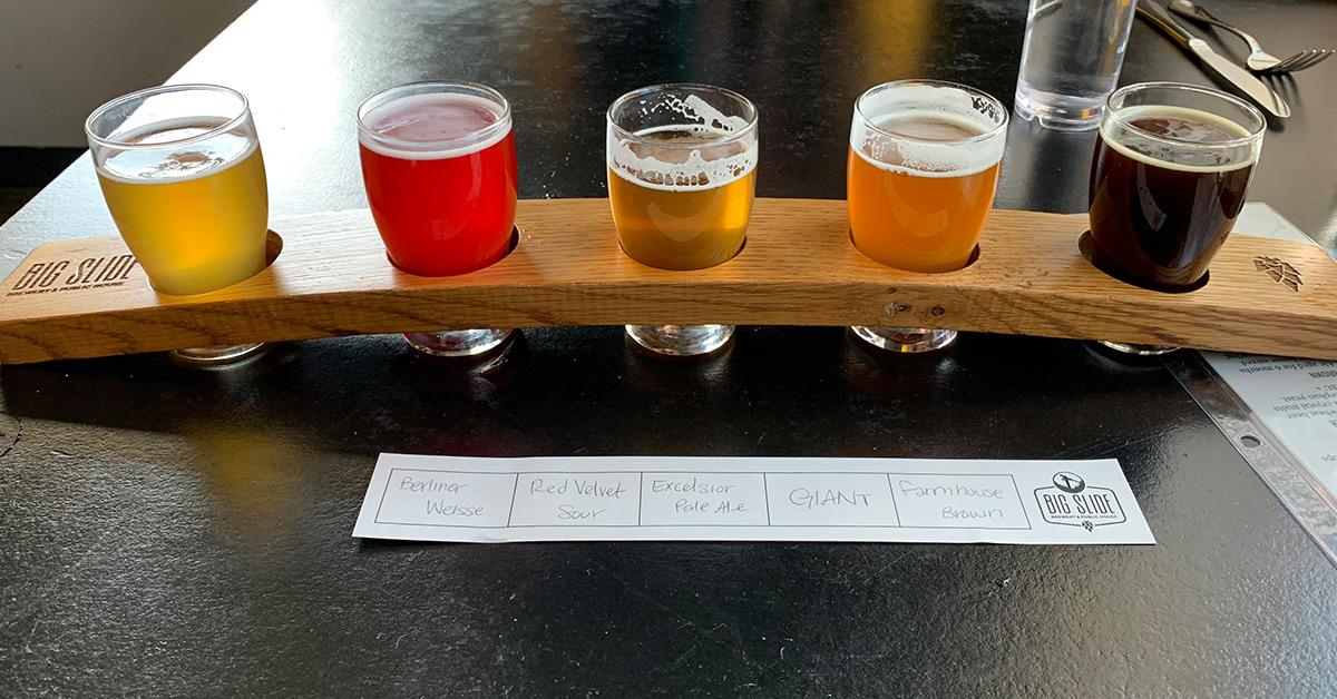 flight of five beers from big slide brewery