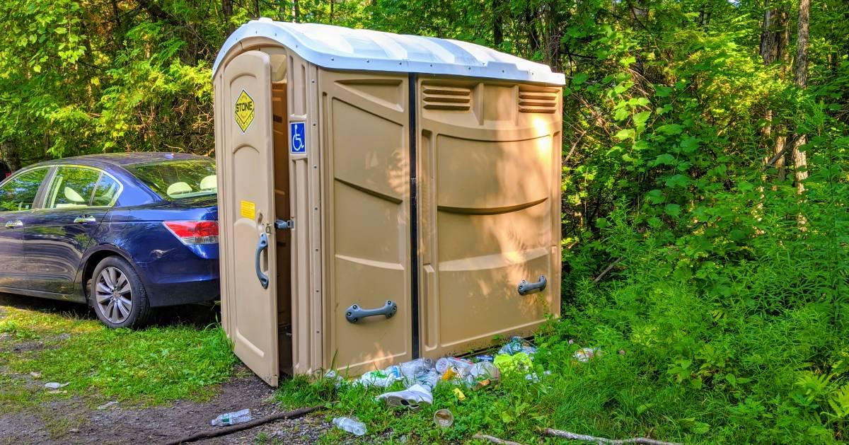 trash by porta potty