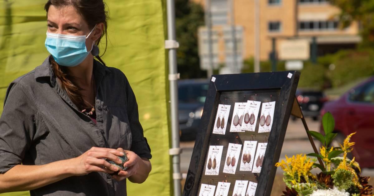 masked woman jewelry vendor
