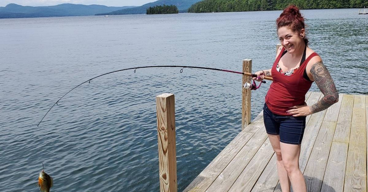 woman fishes on dock