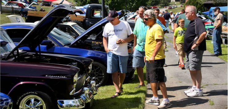 people at a car show
