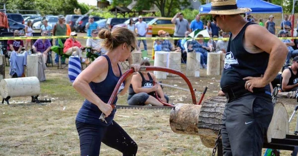 woman saws a log